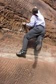 businessman-climbing-a-rock