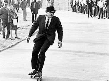 suited-skateboarder